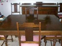 This antique Walnut dining room set c. 1930s was made