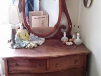 Antique walnut dresser has been refinished and is in