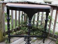 This antique walnut hallway table is stained in ebony