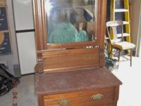 A beautiful antique washstand made from solid walnut