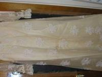 Old wedding dress for sale, not sure what brand it is