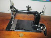 Museum quality Weed treadle stitching machine. Made in
