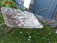 First picture is the antique wheel barrow and the