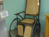Unique and interesting antique wheelchair with an oak