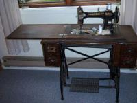 This Antique White Rotary Treadle Sewing Machine and