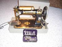 Vintage White Sewing Machine with its original carrying