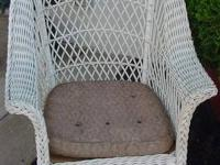 This is a Antique Painted White Wicker Rocker - It has