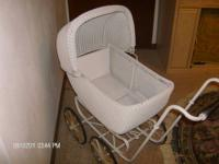 Antique baby buggy in good condition. Hood swivels