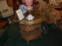 For sale is an antique wicker dining table.  Glass top