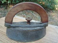 Vintage iron with rounded wood with flat sides handled