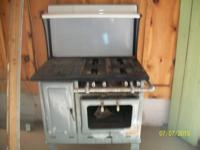 wood and gas cook stove. oven needs glass replaced. Or