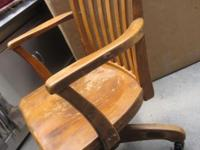 This is a 1930s-1940s Bankers Office Chair, solid wood.