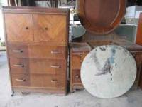 Antique wood dresser and vanity with large mirror. Call