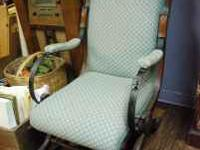 This is a beautiful Antique wood and fabric rocker arm