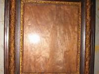 This is a stunning large wooden frame with gold sense