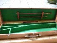 Antique wood gun case with green felt interior.