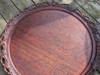 This antique wood piece has been wood burned with the