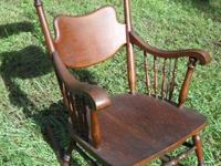 Antique wood rocking chair.  In excellent, sturdy,
