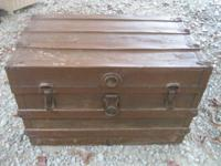 Choice of four antique trunks:. 1) Brown steamer trunk
