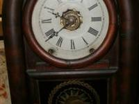 This is an antique Victorian mantel clock made by the