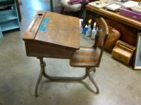 This is an antique abc writing desk with an ink well
