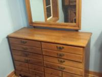 Selling matching wood mahogany chest of drawers with