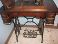 Nice antique Domestic brand treadle sewing machine.