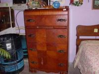 medium color wood antique 4 drawer chest of drawers
