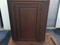 This is an early hanging corner cabinet. It is made
