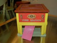 For Sale is an antique fisher price fire station.  This