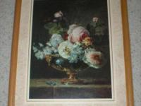 This antique floral print is framed in an oak wood