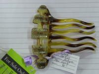 Beautiful comb with small inset stones. Excellent for