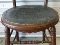 Late 19th century wooden chair with embossed black