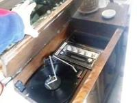 antique Olympic AM/FM stereo with album player cabinet