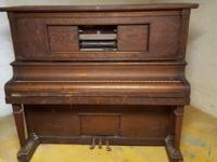 For sale is an antique P.A. Starck Player Piano. It has