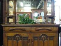 This beautiful sideboard buffet has a large carved
