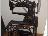 A SINGER MFG HEAVY DUTY SEWING MACHINE FOR LEATHER AND