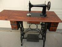 This industrial strength STANDARD sewing machine with