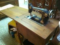 Real neat and real old, table/bench mounted grinder or