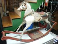 This is a antique, late 1800's, wooden rocking horse.