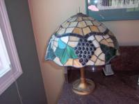 Beautiful antique iron lamp with lovely slag glass