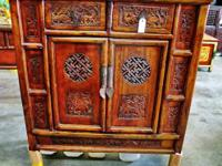 This original handmade Chinese elm wood cupboard