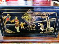 This antiques painted Chinese trunk came from the north
