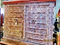 This old teak wood hand made Indian cabinet with brass