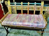 This old Indian iron bench with teak wood came from