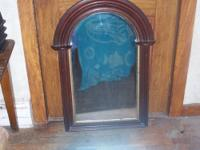 . Antique Gothic mirror, walnut? It has deep molding