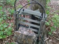 Stand is in very good condition, cushioned seat and