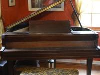 A beautiful 1930's baby grand for sale. In good