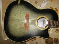 Beautiful accoustic guitar in great shape $125.00 OBO.