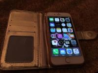Normal wear Apple iPhone 6 with charger and Gold case